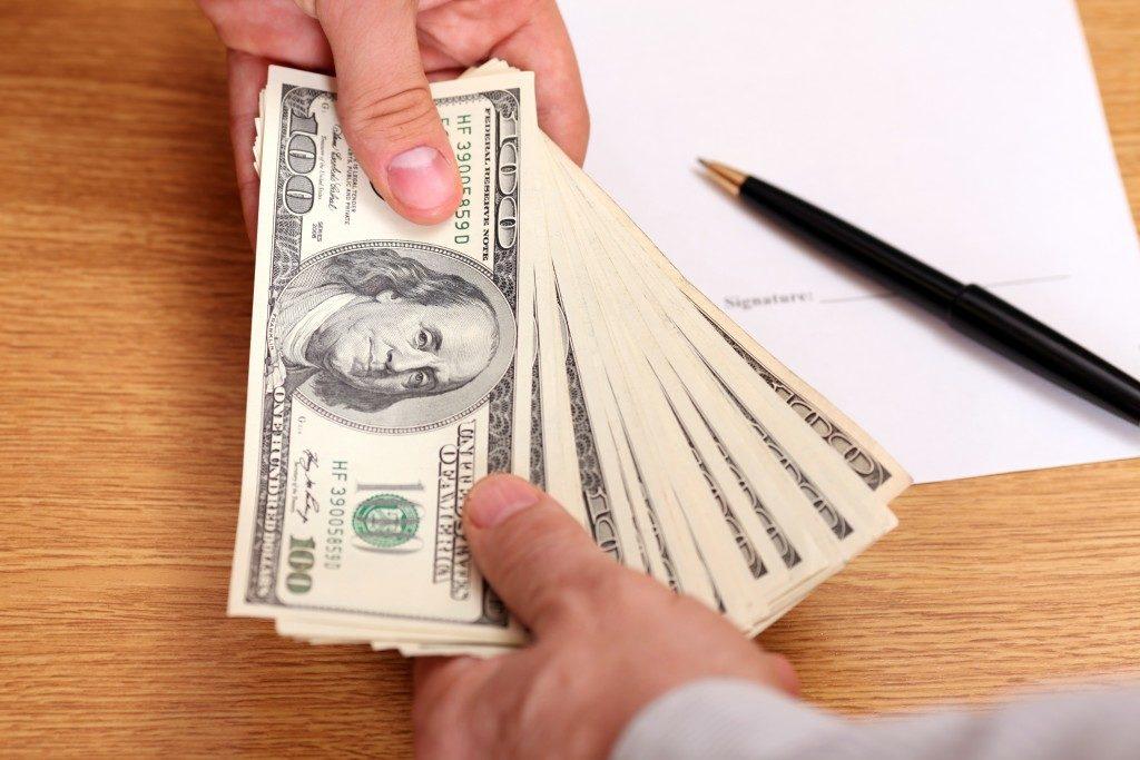 handing payment in cash