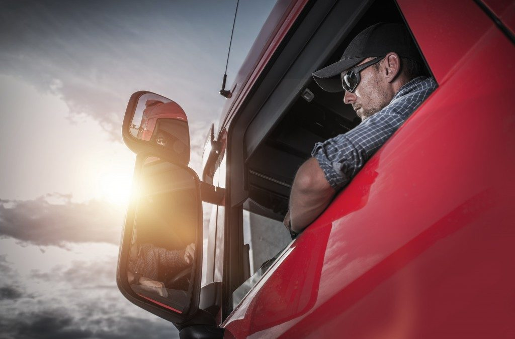 driver inside a red truck