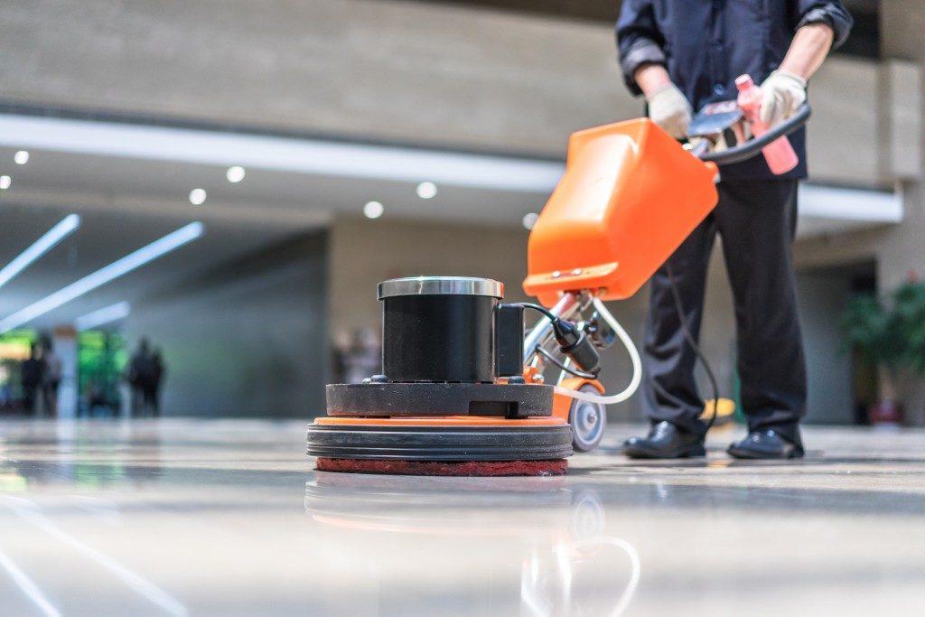 cleaner polishing the floor