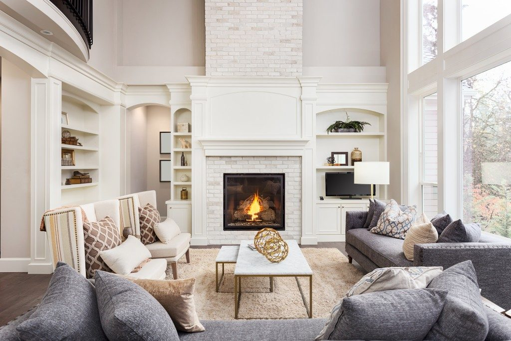 classy home with chairs and sofas around the fireplace