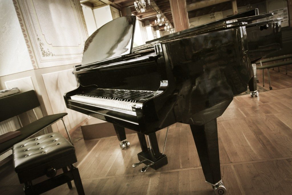 Grand-piano with a chair
