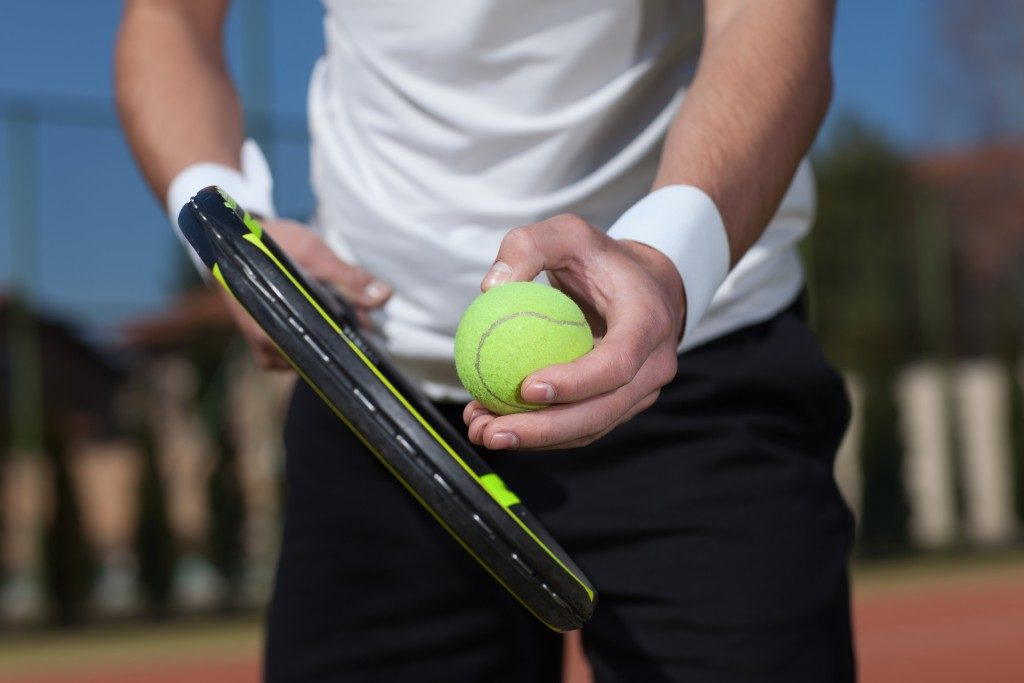 close up shot of a tennis player about to hit the ball