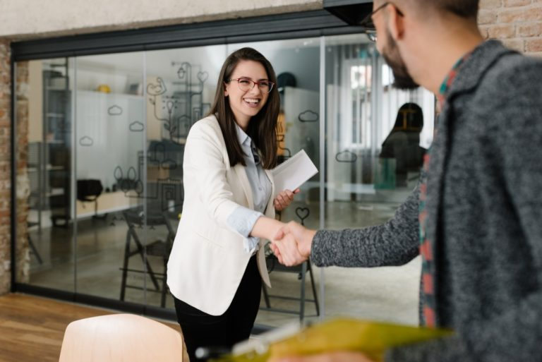 applicant shaking hand of interviewer