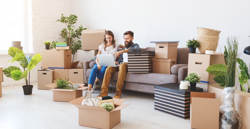couple unpacking items into new home