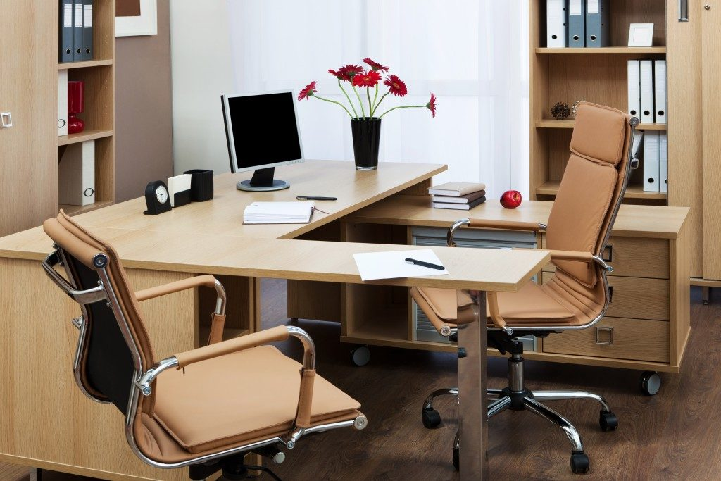 brown furniture and desk in the office