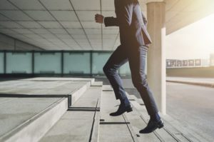 businessman going up the steps