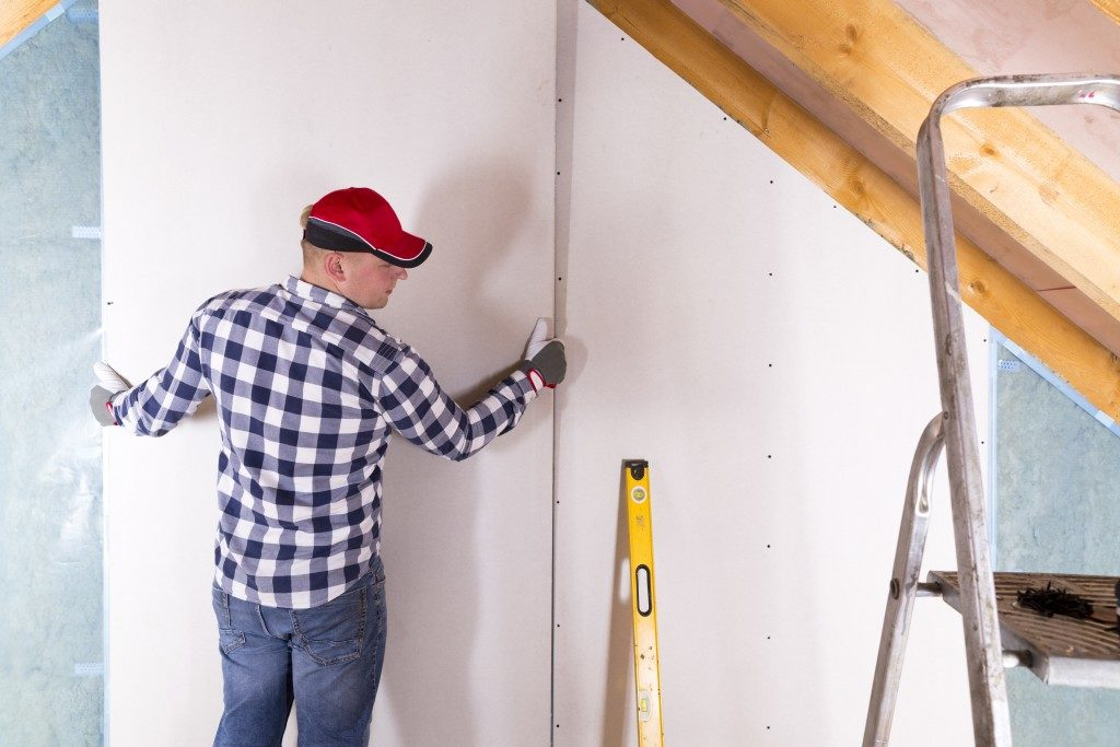 man working on home improvement