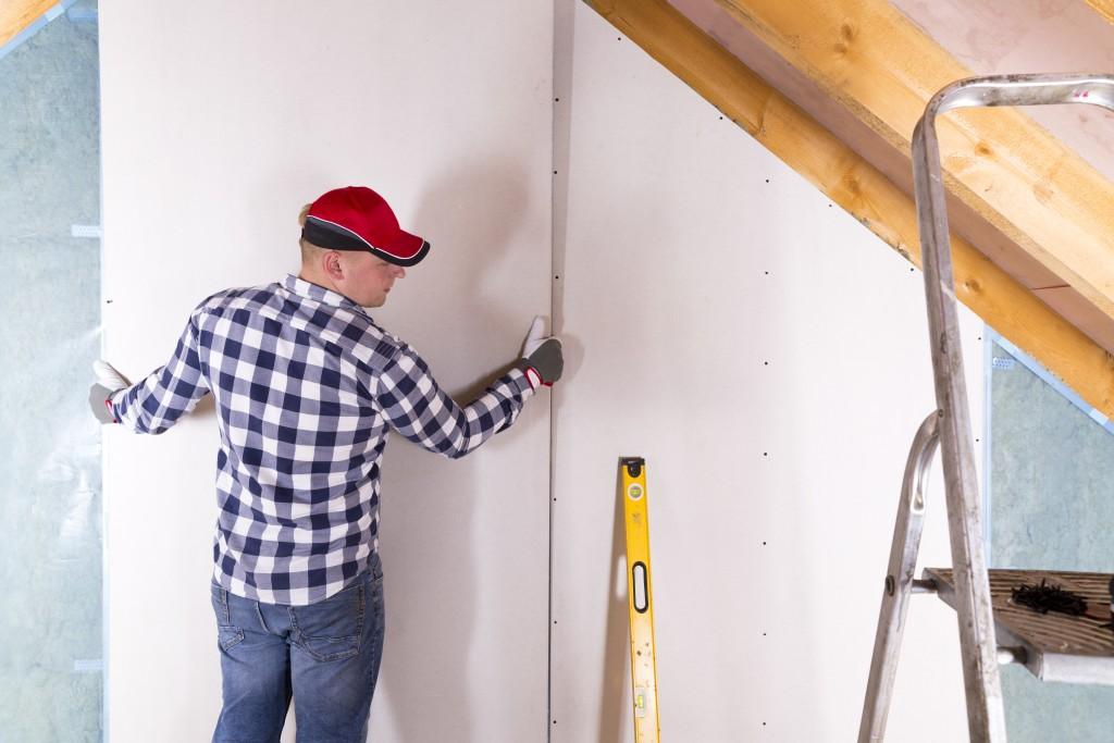 man working on home improvement
