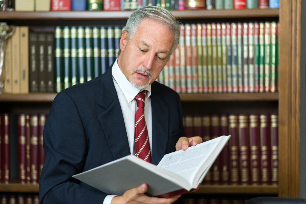 lawyer reading a book in the library
