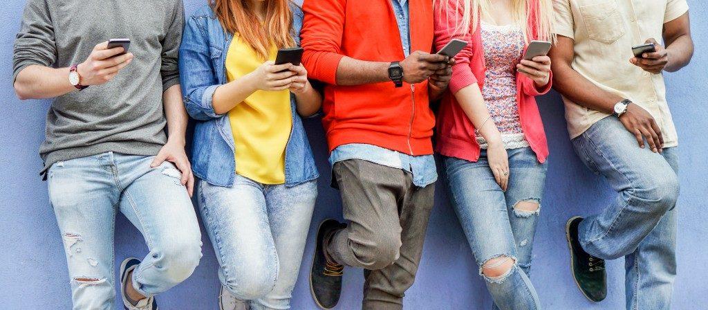 teens on their phone