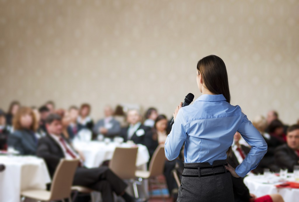 woman speaking in a business conference