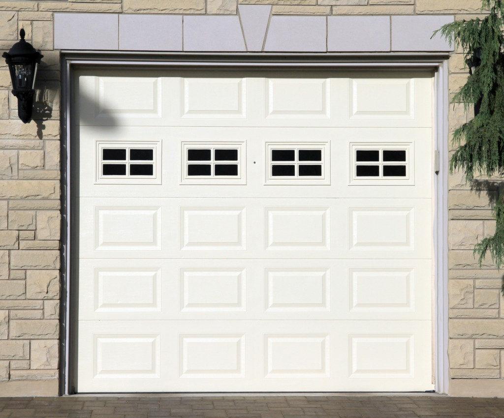 White garage door of a detached house