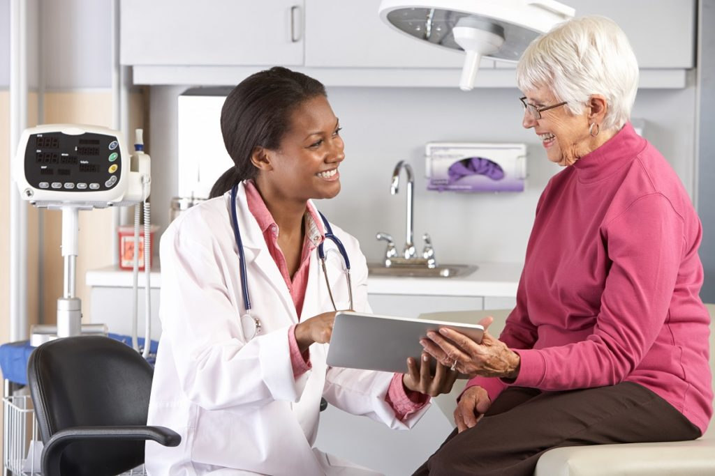 elderly consulting a doctor