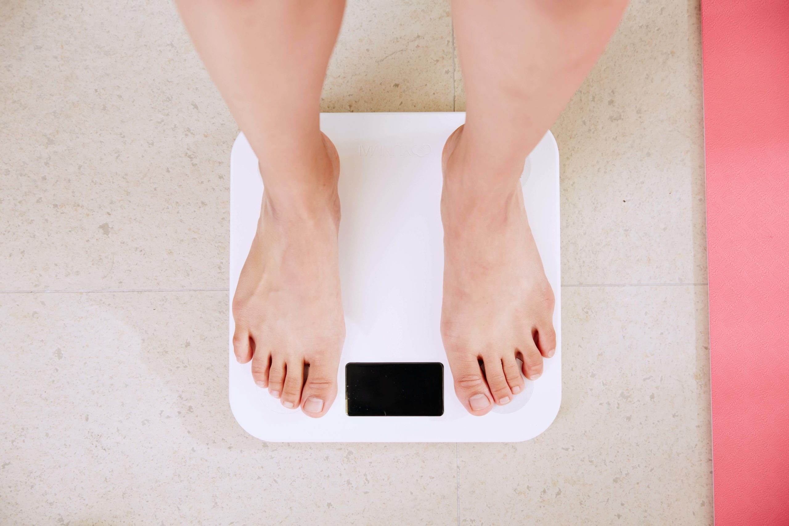 person-on-weighing-scale