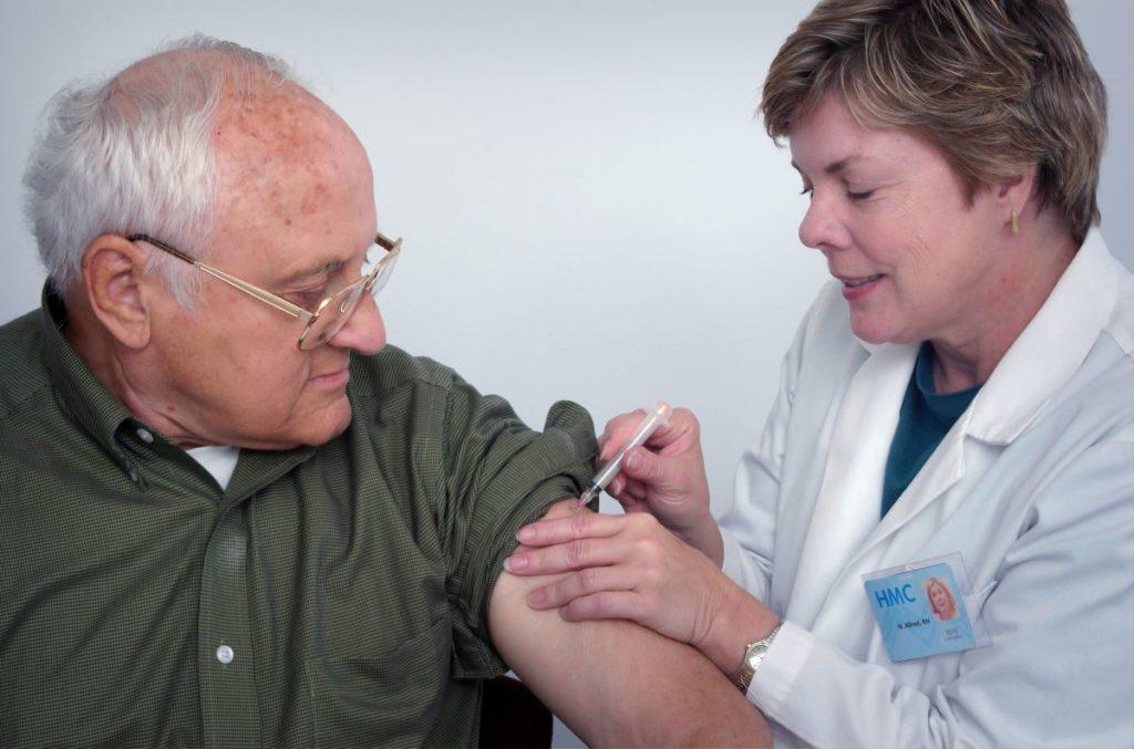 elder man getting vaccination shot