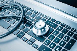 stethoscope on laptop keyboard