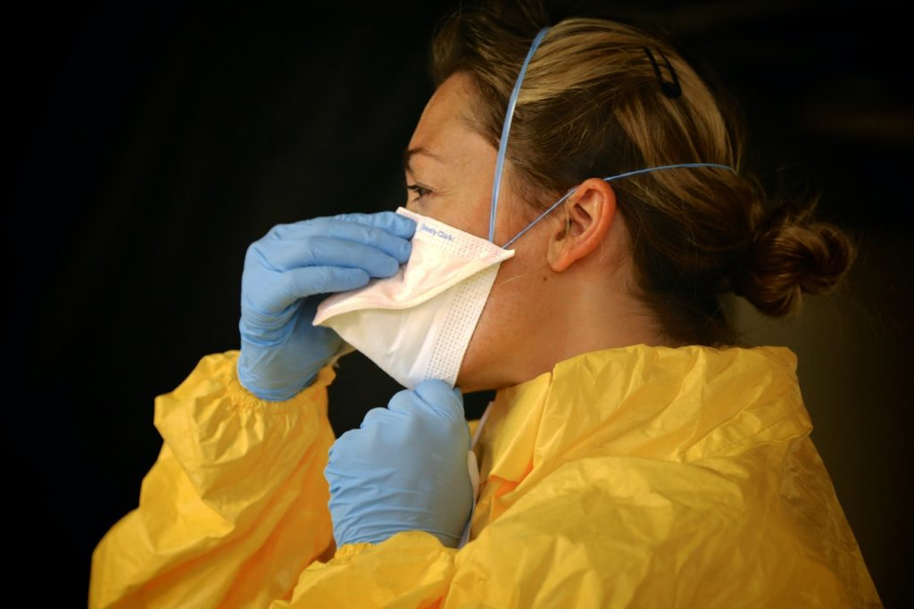 woman wearing facemask and PPEs