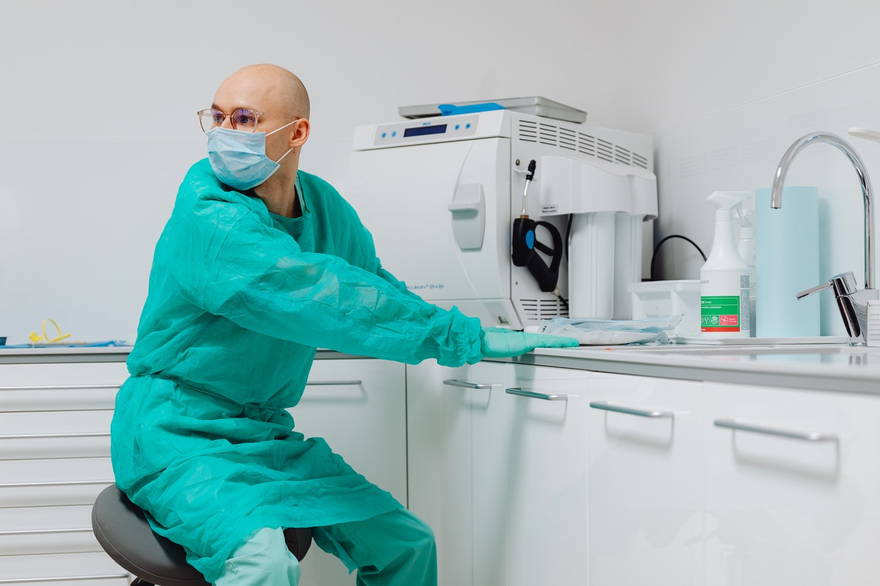 doctor near a large machine