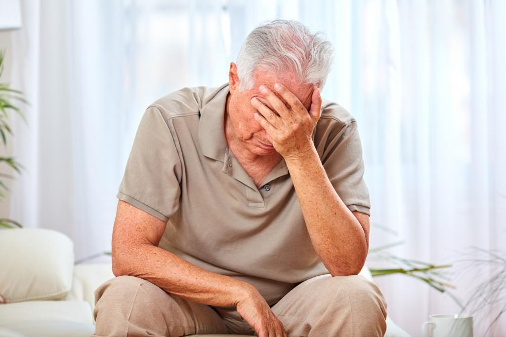 elderly with head ache