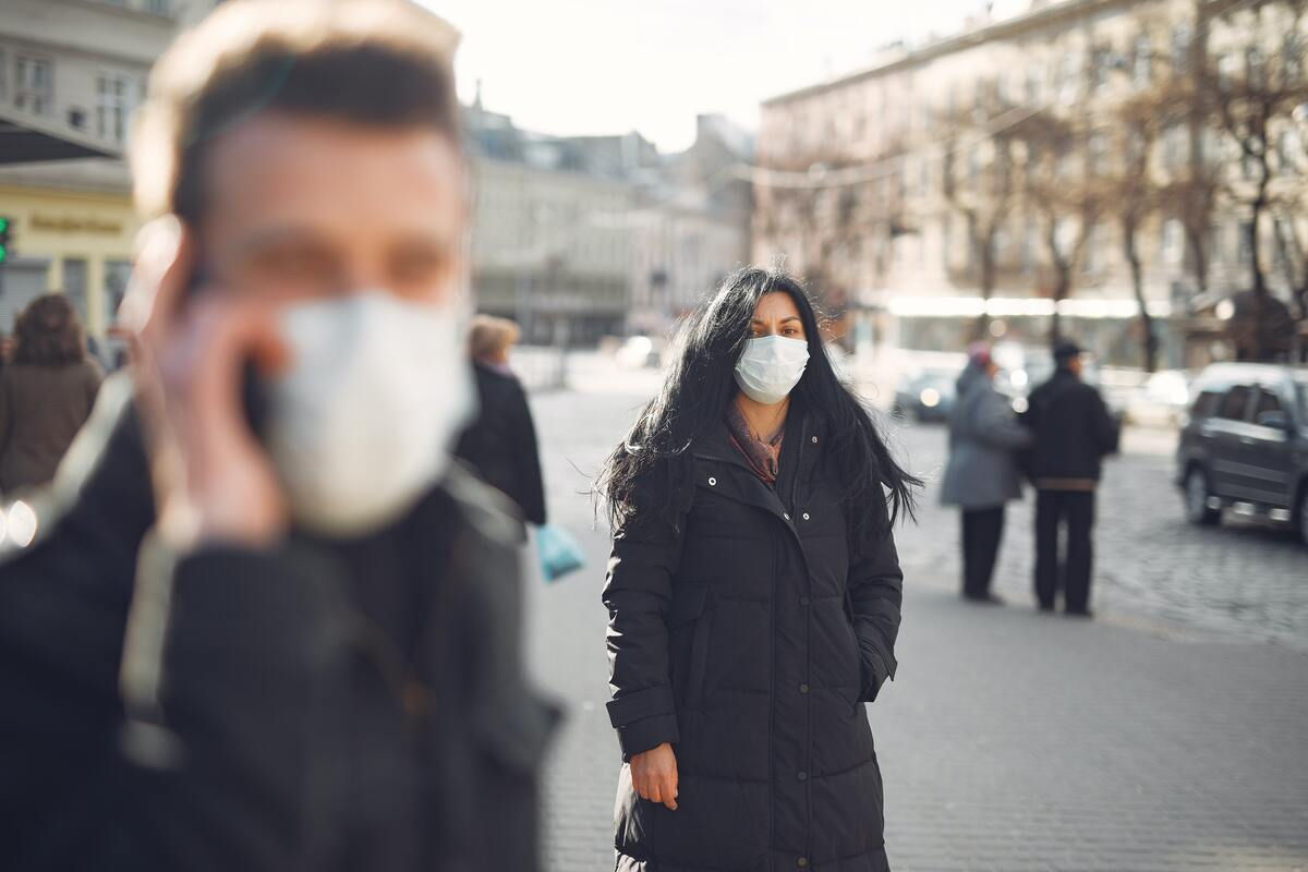 men and woman wearing masks while outside